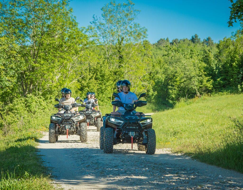 three atv vehicles on a quad tour in central istria