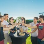 group of people giving a toast with a glasses of istrian wine