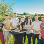 group of people tasting wine