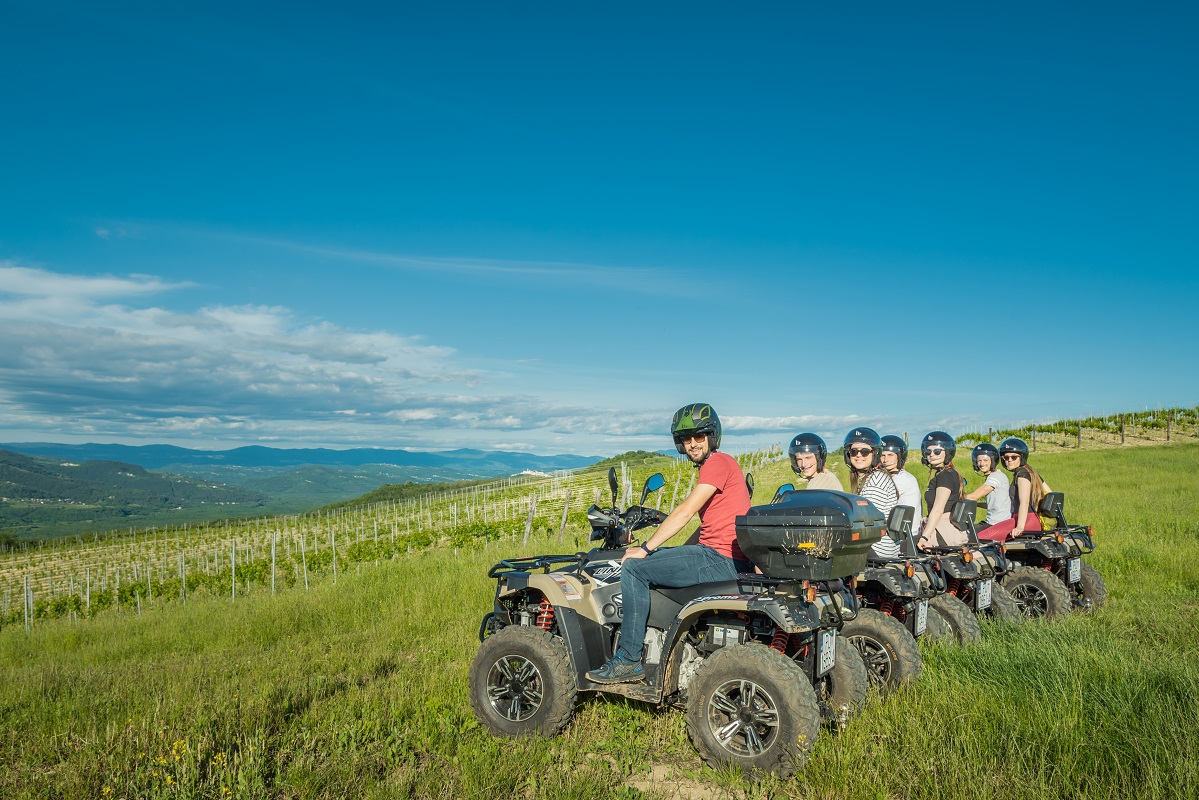 people with quad vehicles and a view on Učka mountain in Istria