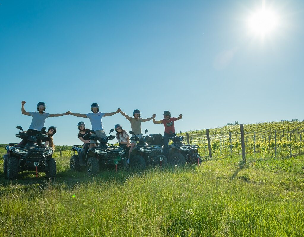 people having fun on the quad tour in vineyards