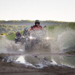 atv vehicle in the mud and water