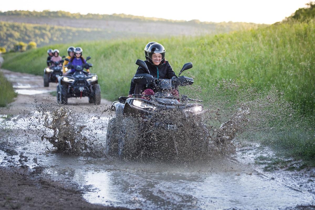 three quads passing trough muddy terrain