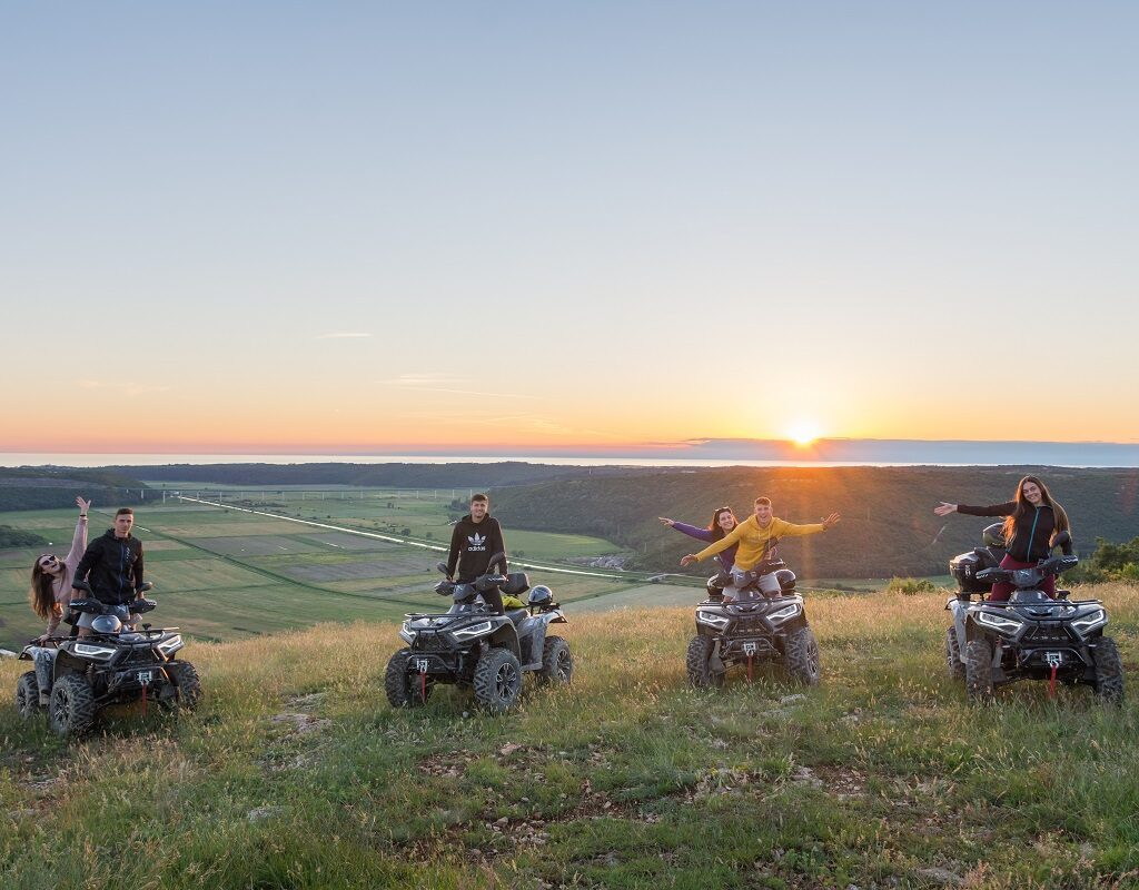 four quad vehicles and a view on the Adriatic sea